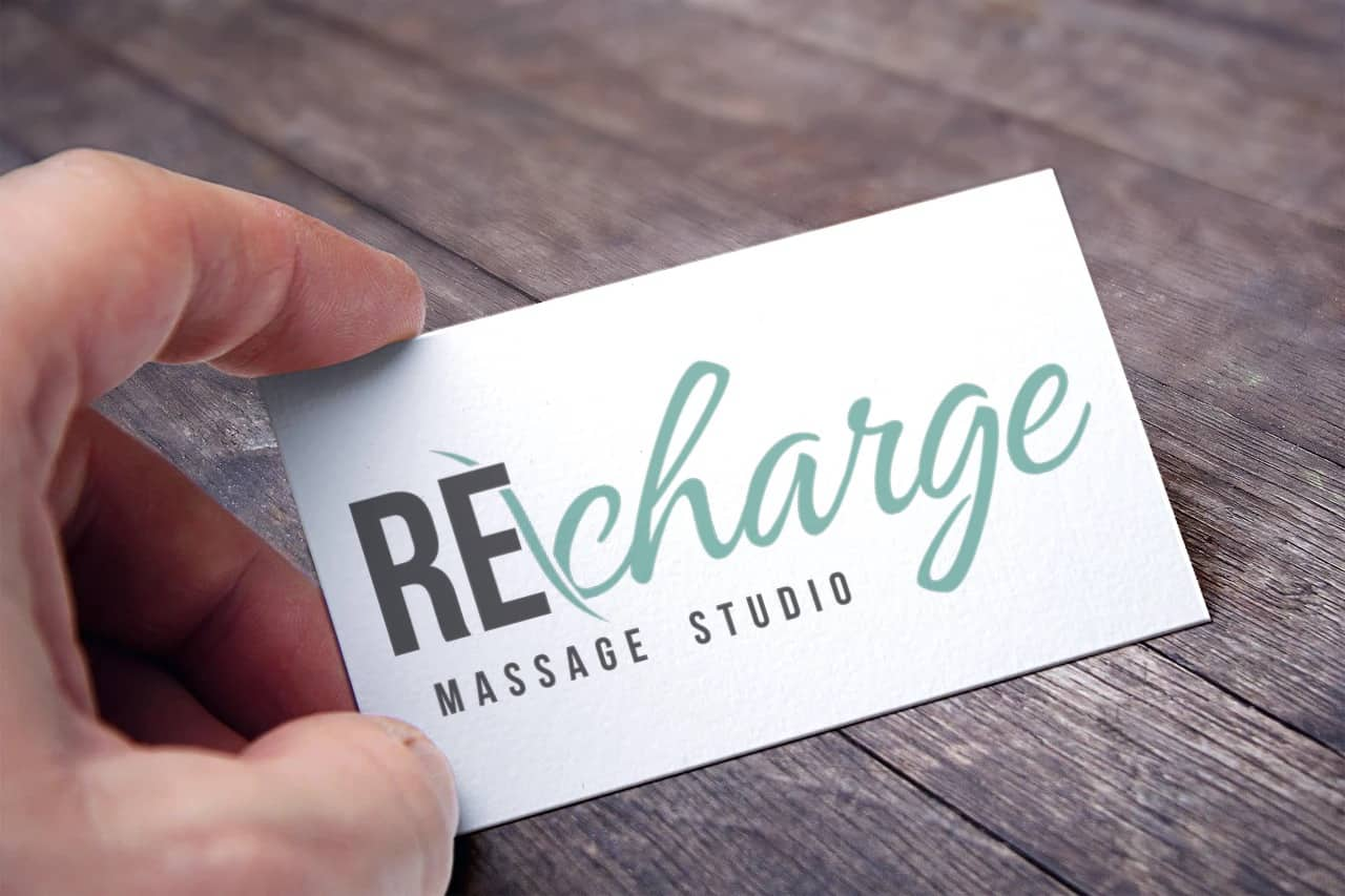 Recharge Massage Studio Logo on a business card